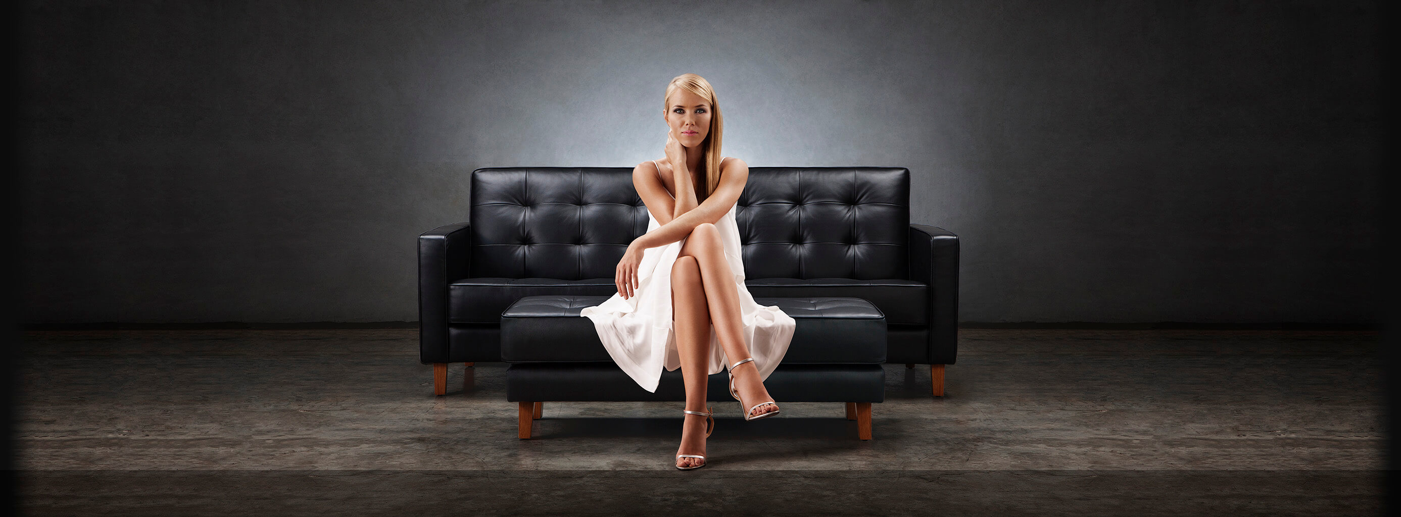 Woman Sitting On Moran Modern Living Sofa and Ottoman